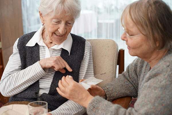 Elderly woman with caretaker picture